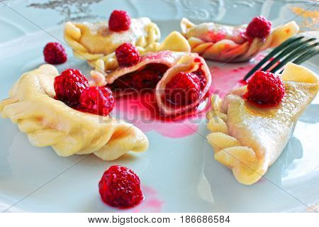 Sweet boiled dough with raspberry food, taste of rural recipe