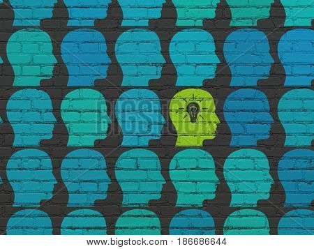 Finance concept: rows of Painted blue head icons around green head with light bulb icon on Black Brick wall background