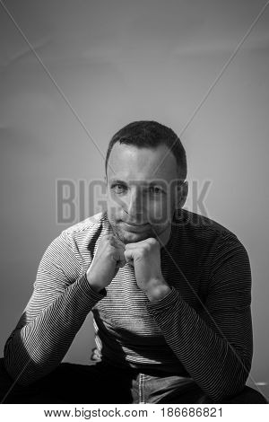 Vertical Black And White Portrait Of Sitting Man
