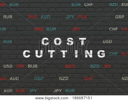 Business concept: Painted white text Cost Cutting on Black Brick wall background with Currency