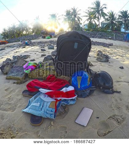 Things of a traveler on the beach of Vietnam, in the rays of the sunset