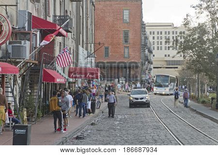 Savannah, Georgia, USA - January 20, 2017: Historic River Street along the Savannah River and the tunnel passageway that divides it. Also called River Street Home the Riverwalk is a popular destination for locals and tourists