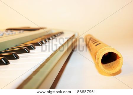 Musical scene with Piano Keyboard and Indian Indian Flute