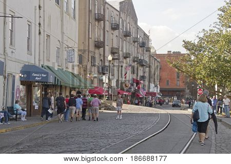 Savannah, Georgia, USA - January 20, 2017: Historic River Street along the Savannah River and the tunnel passageway that divides it. Also called River Street Home the Riverwalk is a popular destination for locals and tourists with its cobblestone streets