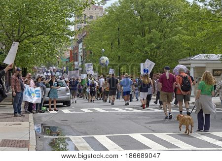 Asheville, North Carolina, USA - April 22, 2017: A large heterogeneous crowd of demonstrators carries signs as they march for science through the streets of downtown Asheville