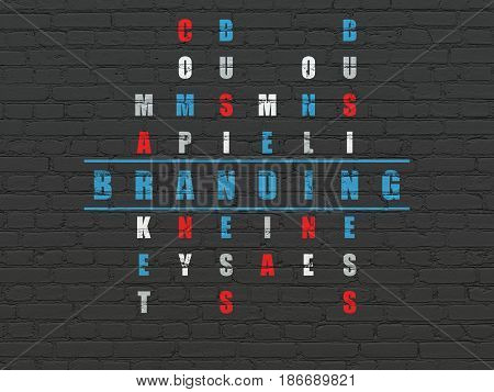 Advertising concept: Painted blue word Branding in solving Crossword Puzzle