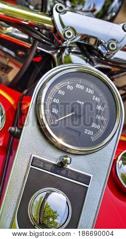 Close up view of speedometer on red motorcycle