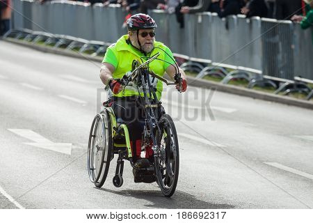 BERLIN - APRIL 03 2016: The annual Berlin Half Marathon. Race through the city streets. Athletes of disabled in wheelchairs.