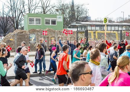BERLIN - APRIL 03 2016: The annual Berlin Half Marathon. Before the start of the marathon. Fans with Danish flags.