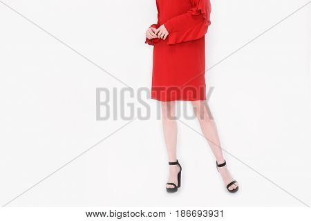 Woman in red sundress . high heels.Perfect female legs posing