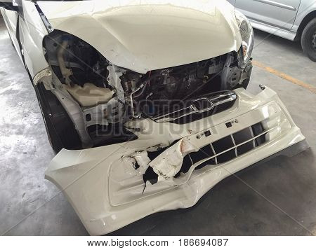 front bumper and rear light damage form car cash for repairing in garage .Car insurance concept