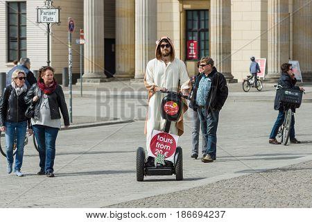 BERLIN - APRIL 03 2016: Promoter tours on Segway on Pariser Platz in front of the Brandenburg Gate.