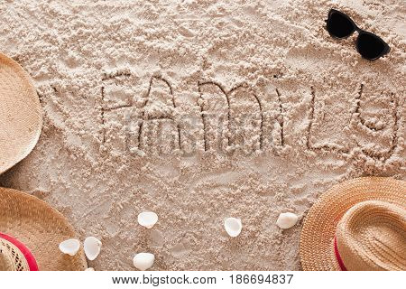 The word Family written in a sandy tropical beach