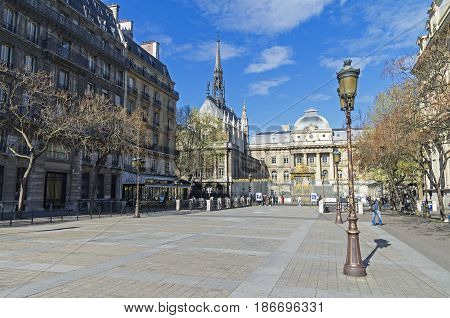 PARIS FRANCE - APRIL 2 2017: View of the chapel of Saint-Chapelle from the square of Louis Lepine. Paris France a sunny day in early April.