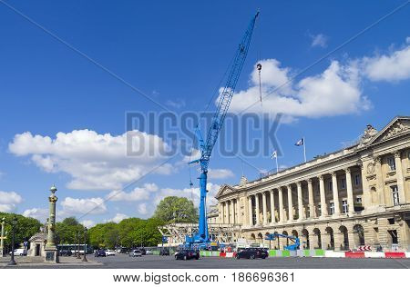 PARIS FRANCE - APRIL 2 2017: A blue crane against a blue sky. Place de la Concorde Paris France. A sunny day in early April.