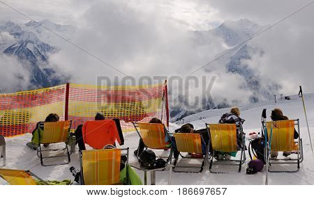Ski vacation -resting skier in ski resort