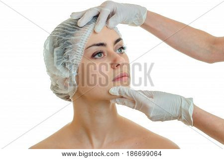 beautiful young girl with a hat on his head in the Medical Office at the beautician gloves isolated on a white background big PL