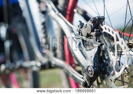 Elements of the suspension of the mtb bike of a two-pendant mountain bike close-up brake disc brake and rear suspension