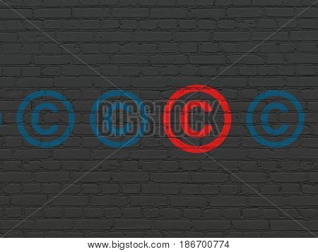 Law concept: row of Painted blue copyright icons around red copyright icon on Black Brick wall background