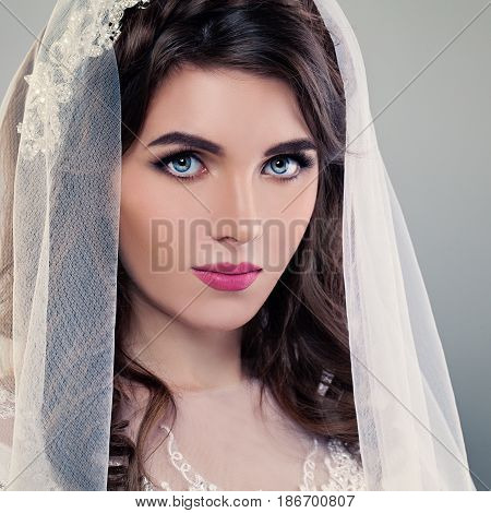 Wedding Makeup. Pretty Young Bride Face Closeup. Cute Woman Fiancee with Veil and Make up