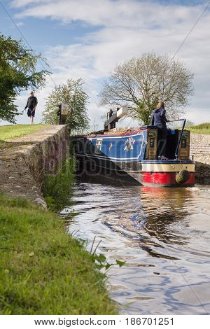 Saint Martins Shropshire UK - May 14 2017: A narrowboat entering the New Marton upper lock gate on the 200 year old Shropshire Union canal