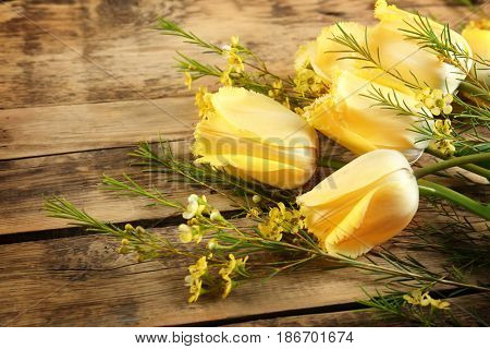 Bouquet of beautiful flowers on wooden background, closeup