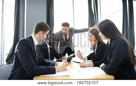 Manager yelling at his employees at the meeting. Company is in recession