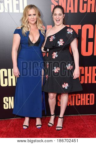 LOS ANGELES - MAY 10:  Amy Schumer and Kim Caramele arrives for the 'Snatched' World Premiere on May 10, 2017 in Westwood, CA