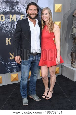 """LOS ANGELES - MAY 08:  Zach McGowan and Emily Johnson arrives for the 'King Arthur: Legend Of The Sword"""" World Premiere on May 8, 2017 in Hollywood, CA"""