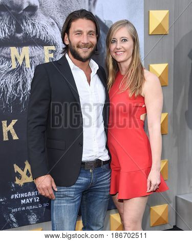LOS ANGELES - MAY 08:  Zach McGowan and Emily Johnson arrives for the 'King Arthur: Legend Of The Sword