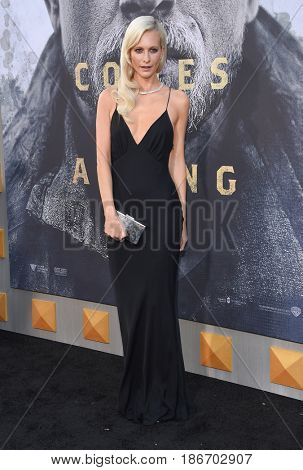 """LOS ANGELES - MAY 08:  Poppy Delevingne arrives for the 'King Arthur: Legend Of The Sword"""" World Premiere on May 8, 2017 in Hollywood, CA"""
