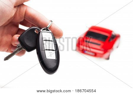 Car new buy concept key luxury focus on foreground