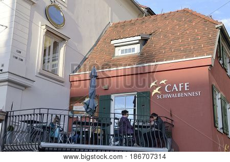 GRAZ, AUSTRIA - MARCH 19, 2017: People at outdoor terrace of a cafeteria in Graz the capital of federal state of Styria Austria.