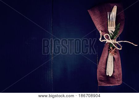Table Setting. Dark Photo, Brown Napkin And Cutlery.