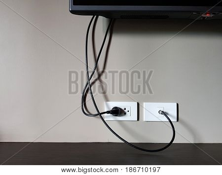 Electrical plug and TV signal outlets on white wall,electronic switch house on white wall - can use to display or montage on product