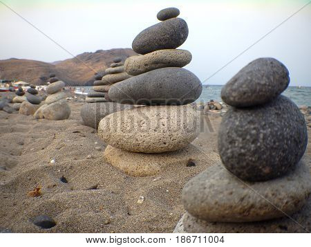 Rocks near the sea, on the sand near the beach in perfect balance.