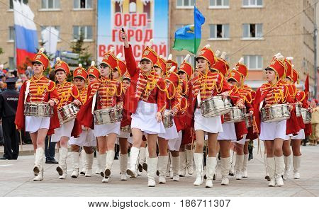 Orel Russia - May 9 2017: Victory Day selebration. Young pretty girls in hussar uniform marching with drums horizontal