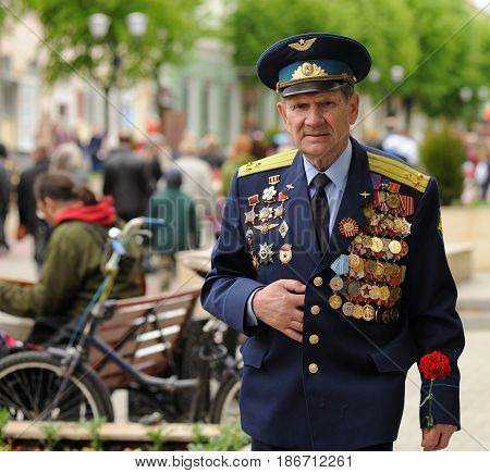 Orel Russia - May 9 2017: Victory Day selebration. Senior man in Soviet war uniform with many medals closeup
