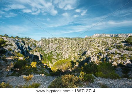 Beautiful Nature Of Calanques On Azure Coast Of France. High Cliffs Under Blue Sunny Sky.