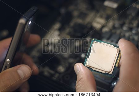 Computer processor. Technician installs CPU on motherboard.