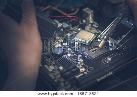 CPU (computer processor). Technician works with motherboard.