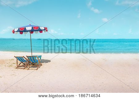 Two canvas beach bed and beach umbrella on the beach with nice sky and cloud at noon time.Holiday concept relaxation
