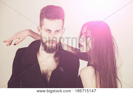 fashion couple. couple of bearded man in coat and pretty woman in black dress with long hair has fashionable makeup fashion style people on white background