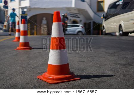 Traffic cone for traffic control. Focus on the foreground.