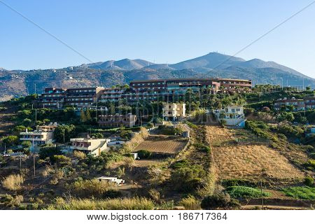 AGIA PELAGIA CRETE - JULY 12 2016: Greece. The island of Crete. Agia Pelagia. Hotels on a hillside in the village Mononaftis. A popular tourist destination.