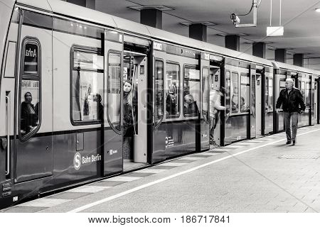 BERLIN GERMANY - APRIL 7: Passengers in train at S-bahn station on April 7 2017 in Berlin