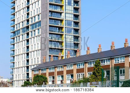 English Traditional Terraced Houses And Modern Tower Block Flats