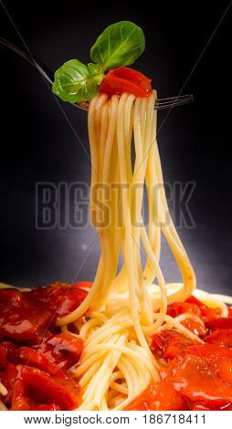 Spaghetti fork italian food carbohydrate tomato sauce close-up