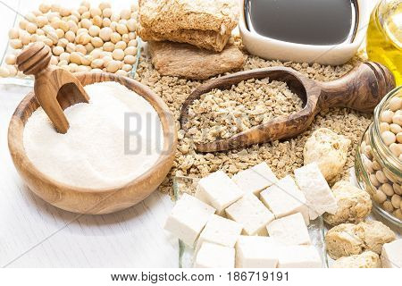 Various soy products on white wooden background