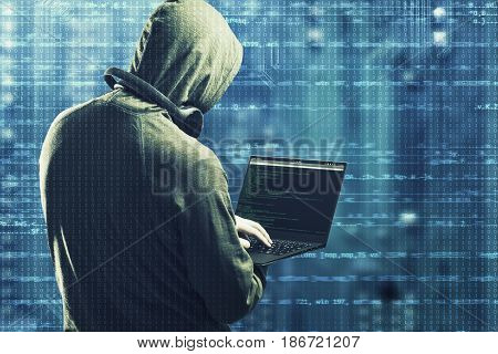 Computer Cyber attack concept. Hacker worling on a notebook.